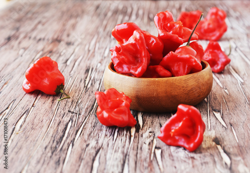 Fotobehang Hot chili peppers red chili peppers strange shapes table, selective focus