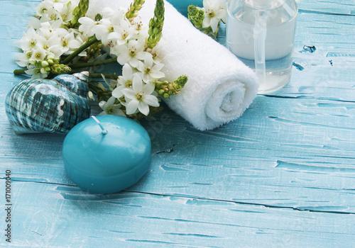 Aluminium Spa White flowers lying on and candle Spa set