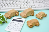 Wooden cars and calculator and keyboard - Purchase of cars, car selection image - 171013423