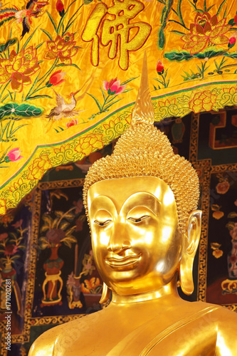 Fotobehang Boeddha golden buddha statue with tradition chinese fabric background.