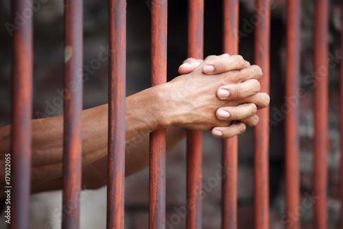hands of prisoner in jail Poster