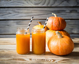 Pumpkins juice in bottle with pumpkins