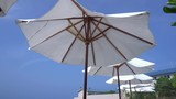 White sun umbrellas on blue sky background, perfect summer vacation on Maldives island - 171033018
