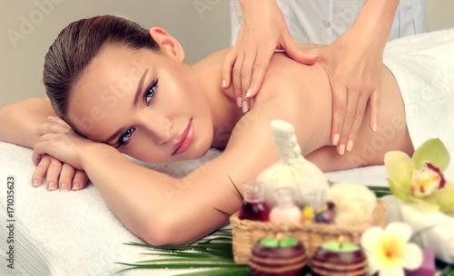 Massage and body care. Spa body massage treatment. Woman having massage in the spa salon for beautiful girl  © Sofia Zhuravetc
