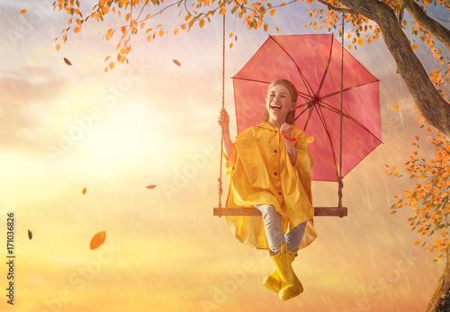 child with red umbrella