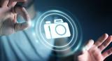 Businessman using modern camera application 3D rendering - 171043403