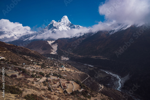 Ama Dablam summit or peak and Nepalese village in Himalayas Poster