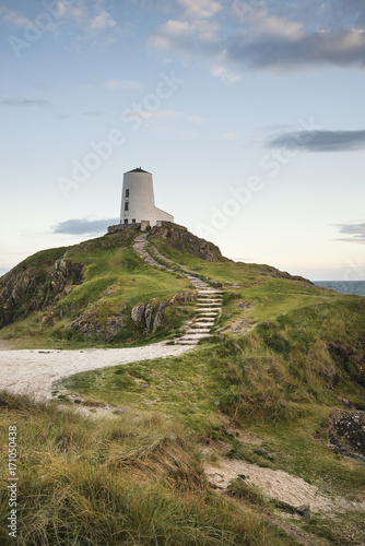 Foto op Plexiglas Blauwe hemel Stunning Summer landscape image of lighthouse on end of headland with beautiful sky