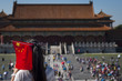 Beijing, China - July 29, 2012: Young Chinese girl with a Chinese Flag in her head at the Forbidden City in the city of Beijing, in China