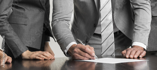 Businessman signing contract - 171068298