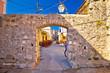 Ancient village of Sukosan near Zadar stone street and arch gate view