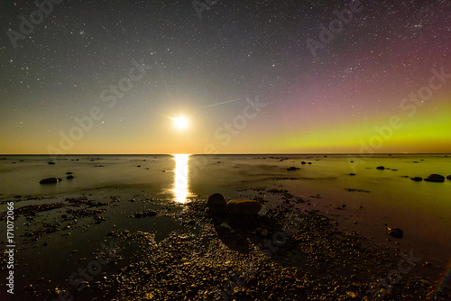 Fotobehang Zee zonsondergang Intense northern lights (Aurora borealis) over Baltic sea