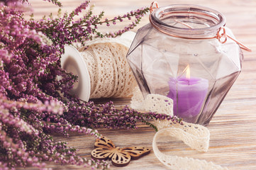 Pink heather, purple candle pot, butterfly