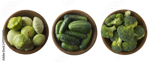 Fotobehang Verse groenten Broccoli, cucumber and squash in wooden bowl. Top view. Vegetables isolated on a white background. Vegetables with copy space for text.
