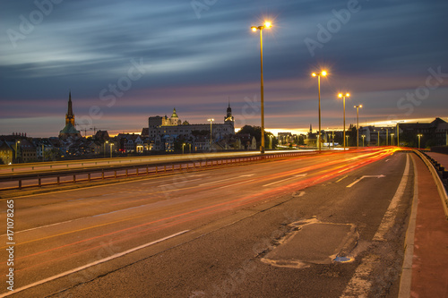 Foto op Canvas Nacht snelweg The road leading to Szczecin after sunset, traces of lights of cars