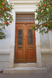 elegant house entrance with wooden door, Athens  Greece - 171079689