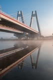 Cable stayed bridge, Krakow, Poland, in the morning fog over Vistula river