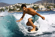 Young man surfing on the wave.