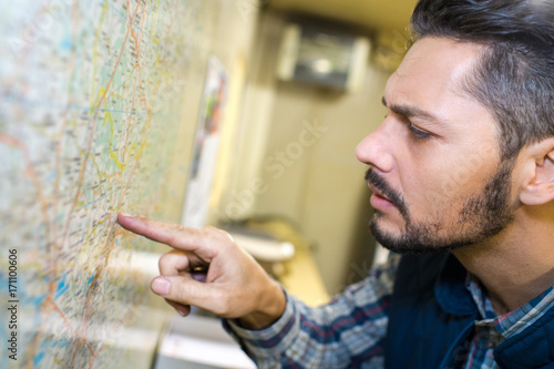 worker looking at a map