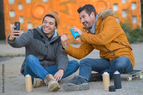 Fotobehang Graffiti graffiti artists posing for a selfie