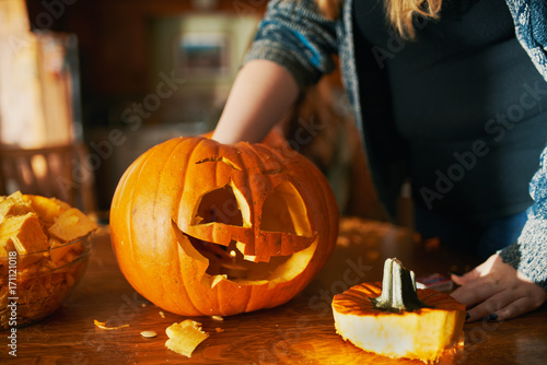 family fun activity - carved pumpkins into jack-o-laterns for halloween close up