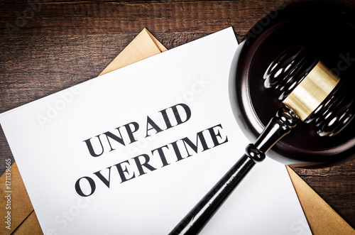 Unpaid Overtime Title On Legal Documents Buy Photos AP Images - Buy legal documents