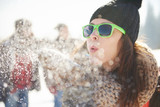 woman blowing the snow in front of camera - 171143202