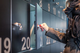 Woman opening a locker at the museum - 171157896