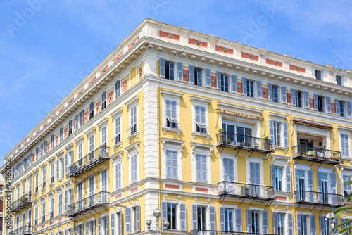 Staande foto Nice Daylight view to yellow building of a hotel in Nice Cote d'Azur, France. Blue sky background.
