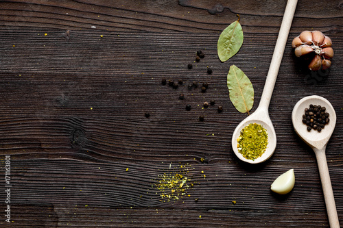 spices in spoon on wooden table top view