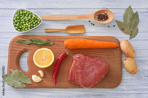 Fotobehang Kruiden 2 Composition with meat and vegetables on wooden board