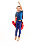 Laughing isolated superhero child jumping high, flying with arm raised - 171166075