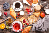 coffee cup,tea cup ,croissant and fruit