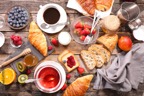 coffee cup,tea cup ,croissant and fruit - 171170645