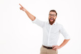 Happy excited bearded man in eyeglasses pointing - 171172682