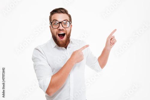 Happy excited bearded man in eyeglasses