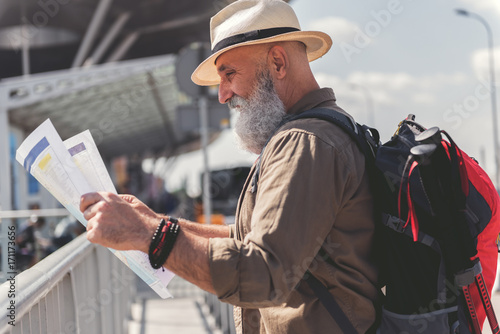 Curious bearded tourist choosing route