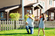 Charming daughter launching paper planes with father