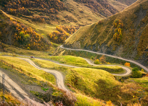 Fotobehang Oranje road winds through the mountains, the autumn in the mountains of Georgia