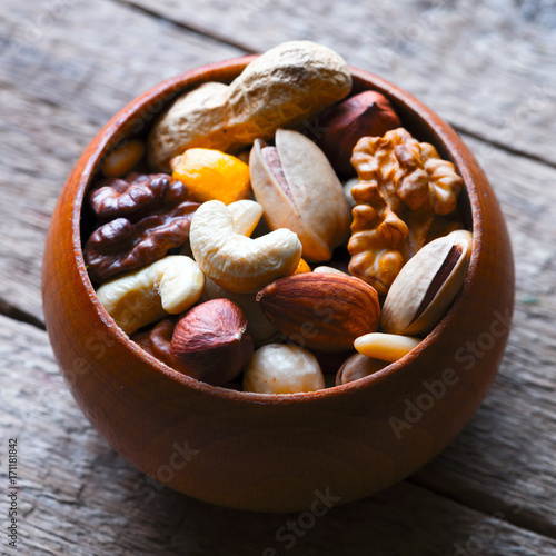 Poster Mixed nuts in wooden bowl