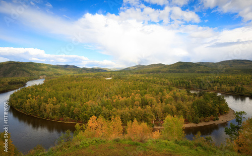 Aluminium Pool beautiful autumn landscape with river and forest under blue sky