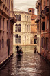Gondola floats along the narrow canal in Venice