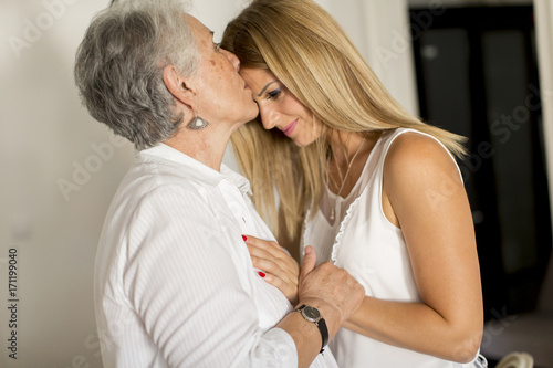 Grandmother kissing granddaughter