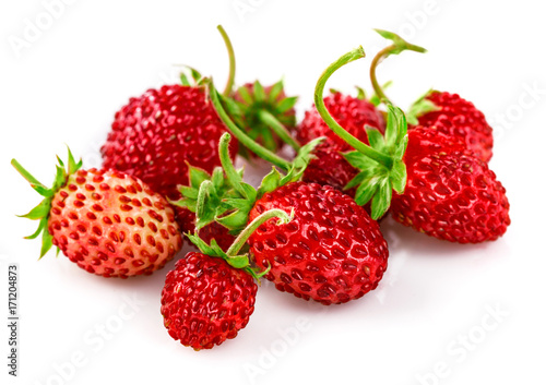 Berry wild strawberry with green leaves handful fresh