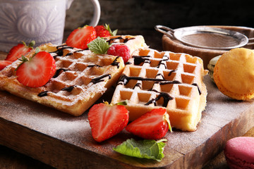 Belgian waffles with strawberries and raspberries, homemade healthy breakfast with coffee