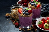 healthy blueberry with granola and berries on a dark background