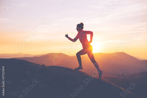 athletic-girl-finishes-a-run-in-the-mountains-at-sunset-sport-tight-clothes-intentional-motion-blur