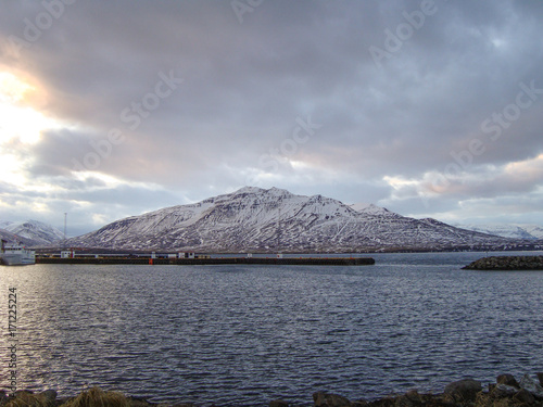 Fotobehang Donkergrijs Mountain view from island of Hrisey in Iceland