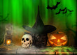 Black dog with Halloween pumpkins on wooden planks.