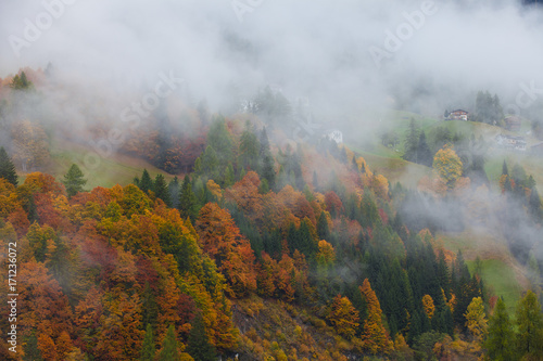 Colorful autumn landscape in the mountain village, morning in Dolimites - 171236072